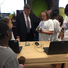 Hailey Forrester, 12 years old, has been a Club member for 5 years and loves the STEM program. Hailey shows the congressman one if the robots her team built and programmed.
