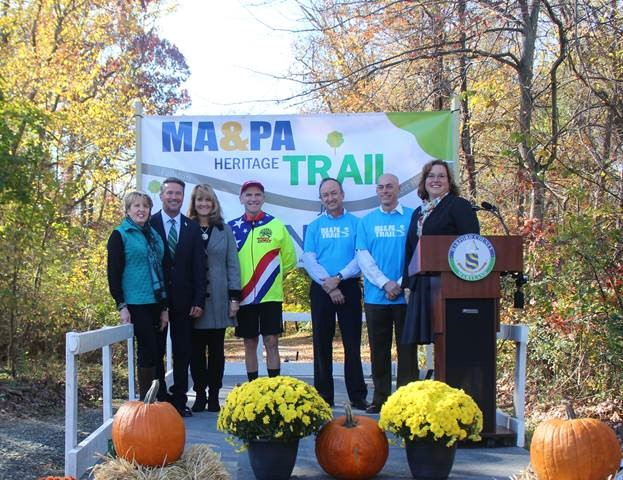 Pictured from left: Bel Air Mayor Susan Burdette; Harford County Executive Barry Glassman; Cindy Hooper Hushon; David Hooper; Ma & Pa Heritage Trail Foundation officials Philip Hosmer, president, and Rod Bourn, past president; Harford County Director of Parks & Recreation Kathy Burley