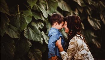 mother holder her child smiling