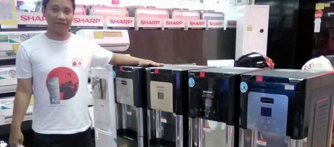 Dispenser Sharp (sumber: tribunnews.com)
