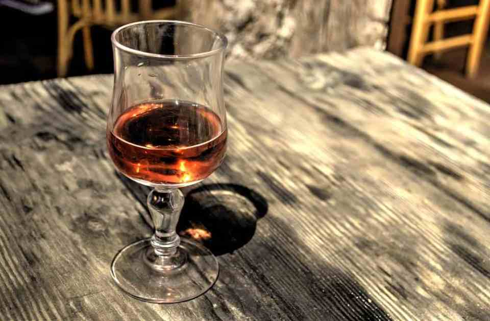 glass of rose wine on wooded table