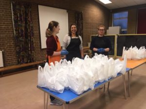 Volunteers hand out food packages at Muswell Hill Baptist Church soup kitchen
