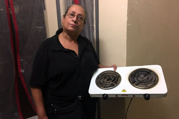 Residents of an apartment building where some units haven't had cooking gas in more than a year are suing the landlord of neglecting the building and some are withholding their rent.