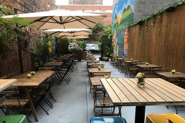 Avacant lot on 120th Street is nowan outdoor Brazilian restaurant.