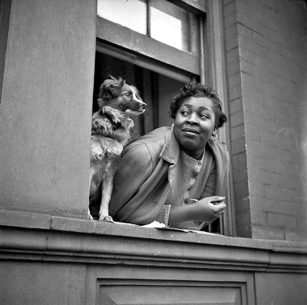 Gordon Parks - A woman and her dog in the Harlem section 1943