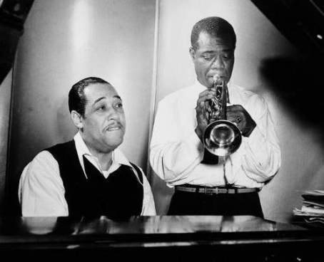 "Duke Ellington at the piano and Louis Armstrong on trumpet rehearse Leonard Feather's ""Long, Long Journey"" during a session at the RCA Victor recording studio in New York Jan. 12, 1946. (AP Photo)"