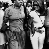 Harlem's Maya Angelou And Gloria Steinem Marching Arm In Arm, 1983