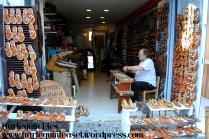 A shoe-maker hand-making sandals