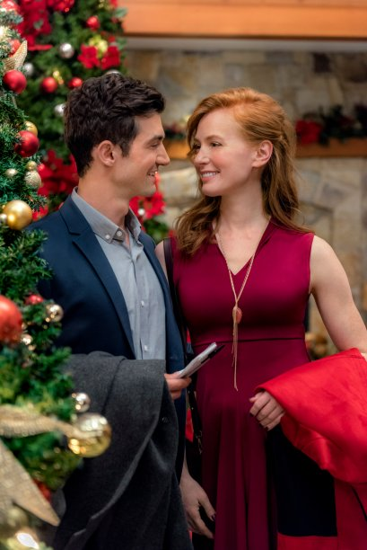 When aspiring romance novelist Kim Rossi (Alicia Witt) is unceremoniously dumped by her soon-to-be-published romance novelist boyfriend, Garth (Casey Manderson), Kim takes stock and decides to take a leap. She signs up for a romance writing retreat at a quaint Vermont Inn shortly before Christmas, where a top romance novelist is scheduled to attend. Shortly after arriving, she crosses paths with Zeke (David Alpay), whom she initially finds to be intrusive and, naturally, ends up being her assignment partner. Worse yet, her ex-boyfriend, Garth, is also at the retreat. Despite these bumps in the road, Kim steps outside her comfort zone and ends up surprising herself. Equally unexpected is the attraction that seems to be building between her and Zeke that promises to take her down a road she never imagined traveling. Photo: David Alpay, Alicia Witt Credit: Copyright 2017 Crown Media United States LLC/Photographer: Kailey Schwerman