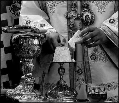 In Orthodoxy during transubstantiation (Θεία Κοινωνία) we eat a small piece of bread in a small spoon of red wine (which are transformed to the blood and body of Christ during the Mystery)