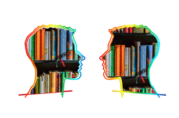 Two head facing each other with books inset in each head