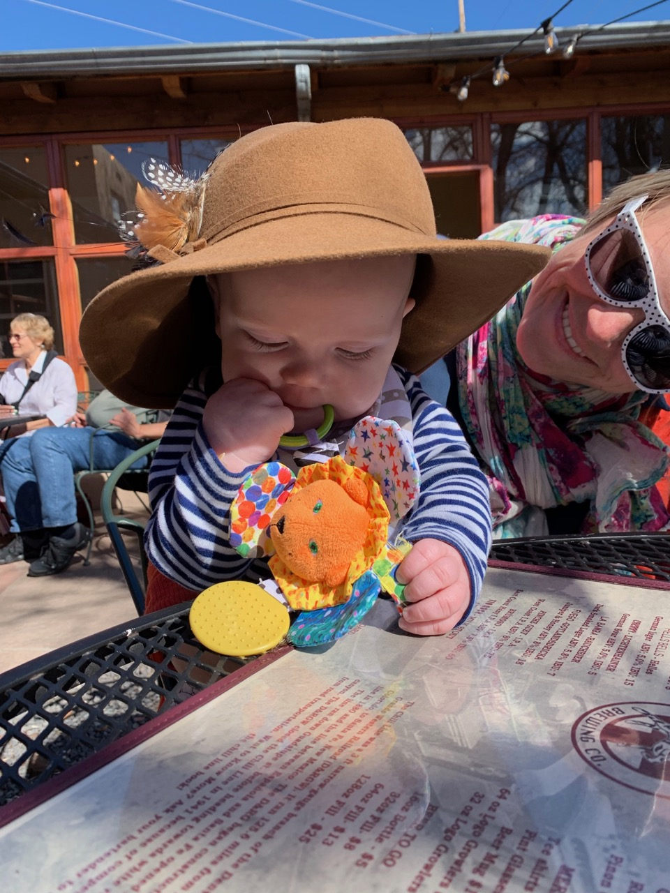 Mom and László wearing Mom's hat