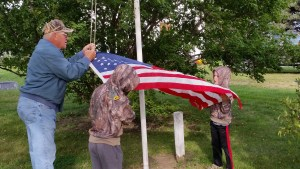 The boys learned flag etiquette from their Grandpa - a farmer and past member of the National Guard while raising the flag at our country church. God, Country, Farmer
