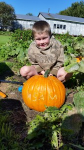 Sam with his name pumpkin.