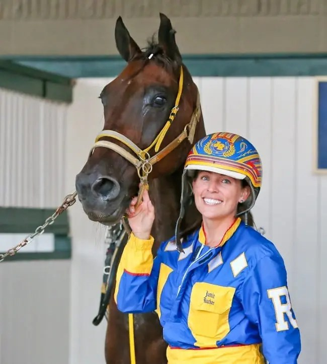 After working for Ron Burke for 10 years, Jamie Macomber (with the great Foiled Again at the 2015 Dan Patch) is going out on her own with her husband, Ricky Macomber | Dean Gillette