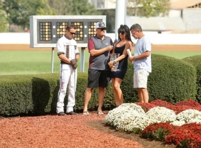 Dave Landry Brian Sears, Nick Salvi, Michelle Crawford and Albert Crawford in the winner's circle after Homicide Hunter set the world record.