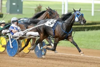 Dave Landry | Atlanta won the Hambletonian and Kentucky Filly Futurity (shown with Scott Zeron) in 2018 and now is embroiled in an ownership dispute with the majority owners selling her to try to buy out trainer Rick Zeron.