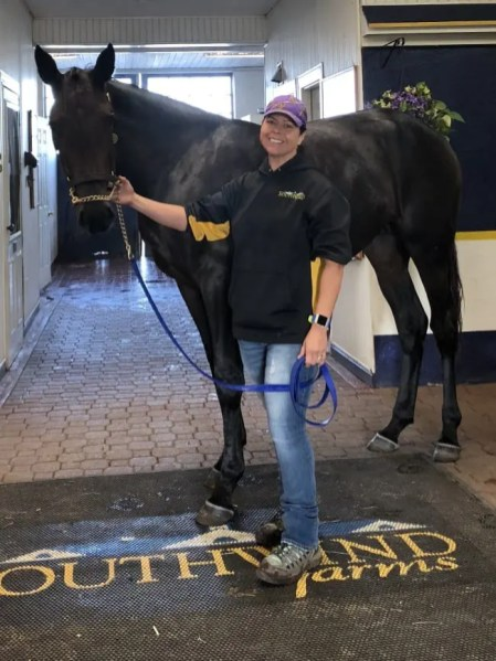 Courtesy Laura Young | Laura Young with 2-year-old Well Said—Southwind Solara filly Southwind Spring.