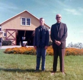 Courtesy Dean A. Hoffman | Dean Hoffman and his father at Walnut Hall Farm in the early 1960s. The yearling barn behind them burned in 1967.
