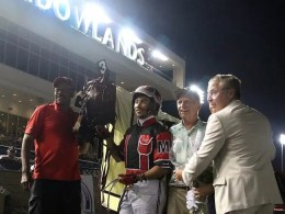 Michael Lisa | Team Lather Up after equalling the 1:46 world record last Saturday at the Meadowlands (from left): trainer Clyde Francis, Montrell Teague, owner/breeder Gary Iles and presenter Jason Settlemoir.