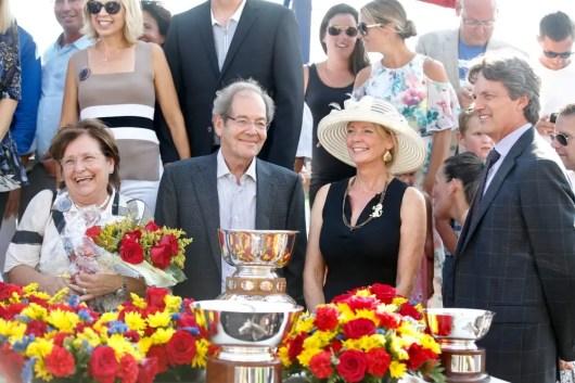 Dave Landry Owner Serge Godin (center) with Forbidden Trade's breeder Steve Stewart (far right) and his wife, Cindy Stewart.