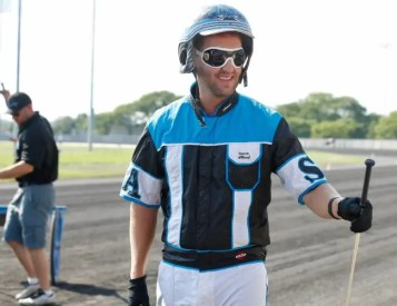 Dave Landry | Simon Allard used his idol Herve Filion's last whip while winning the Hambletonian Oaks with When Dovescry.