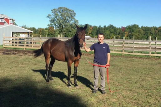 Courtesy Blake Andrew | Blake Andrew with Meridian Trot yearling Lights Out Alice (Muscle Massive—Betweentwopillows) who will sell at the Standardbred Horse Sales Company's auction in Harrisburg, PA.