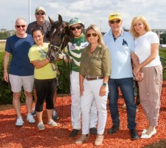 Nigel Soult | Some of Elver Hanover's connections after the 2-year-old gelded pacer recorded a 1:48.3 world record on Saturday at Lexington, KY's Red Mile (from left): Larry Karr, Phil Collura, caretaker Jen Thomas, Yannick Gingras, Dr. Bridgette Jablonsky, Jerry Silva and Theresa Silva.