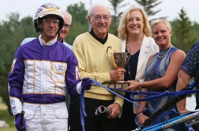 Claus Andersen | McWicked's owner, Ed James (center with Coleman (far right) and Miller (far left)) has offers to stand the pacing star in many jurisdictions.