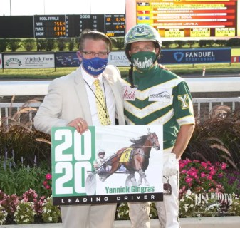 Lisa Photo | Meadowlands chief operating officer and general manager Jason Settlemoir (left, honoring Yannick Gingras as the meet's top driver) led a team that had to figure out how to stage Hambletonian Day safely during a pandemic.