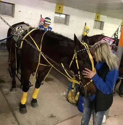 "Courtesy Sarena Evans | Minutes before sending Santas Special out for his final race, trainer Sarena Evans said she was ""bawling and telling him how much I loved him and thanking him for being such an amazing horse for me."""