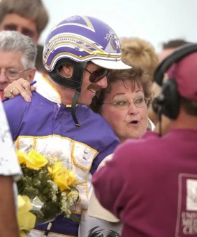 Dave Landry | Miller celebrated with his mom in the winner's circle. His late father took him to the Jug many times as kid, but did not live to see David win it.