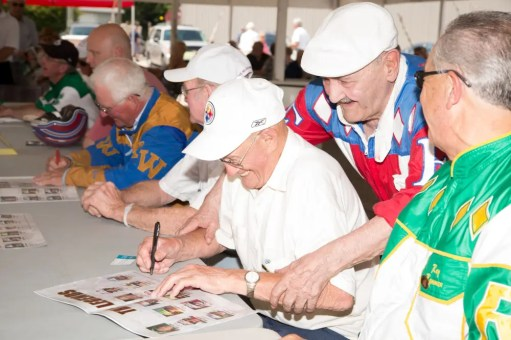 Dave Landry | Keith Waples signing autographs at Legends Day at Clinton Raceway in 2013 with Herve Filion pitching in to help.