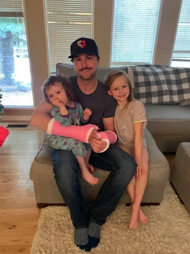 Courtesy Jodi Loftus   Driver Brandon Campbell suffered two broken wrists in a racing spill Sunday at Century Mile and asked for pink casts to the delight of his daughters Blakely (left) and Presley.