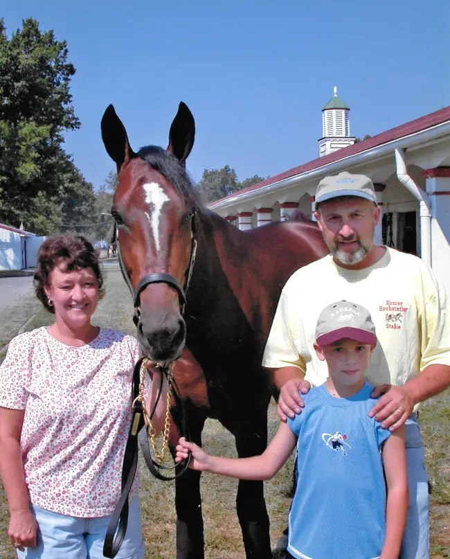Courtesy Connie Hochstetler | Connie and Homer Hochstetler with their son, Jay, and their world champion Kadabra.