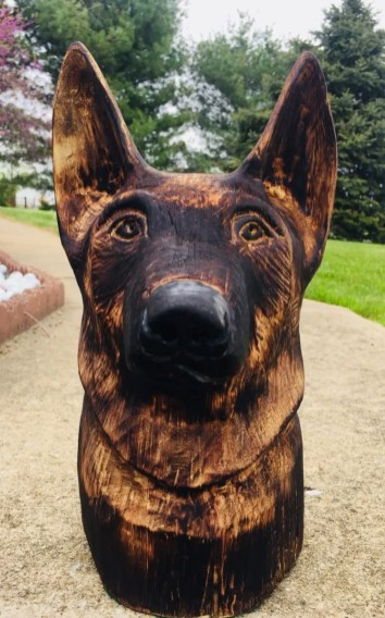 Courtesy Garrett Bell   Bell started his woodcarving hobby by carving a few Krampus masks and then graduated to carving dogs.