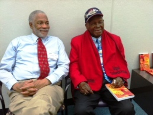 Harold Michael Harvey and Lieutenant Calvin Spann chatting at Southwest Airlines Dallas Headquarters February 5, 2013. Spann had come out for an autograph copy of my novel Paper Puzzle. Photo Credits: (c) 2013 Cyn Harvey