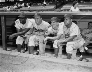 Jackie Robinson, Harold Pee Wee Reese, unidentified player and Roy Campanella. Photo Credits: Pet-dictionary.com