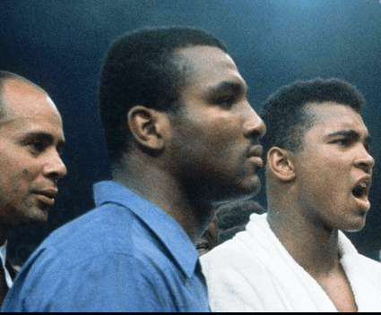 Abdul Rahman on the left  and Muhammad Ali during one of Ali's bouts. Rahman is not surprised that Minister Farrakhan was not invited to speak at the Interfaith Service for Ali.