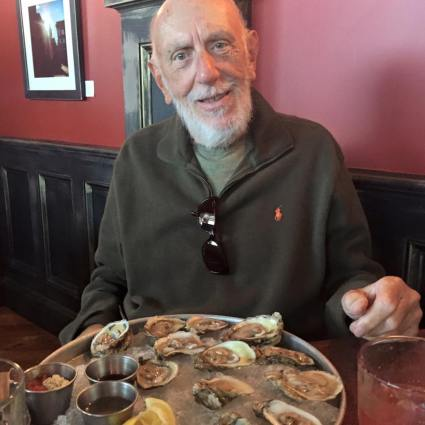Chuck Hampton loved oysters and beer. Here he is pictured at his favorite neighborhood pub with a planter of oysters.