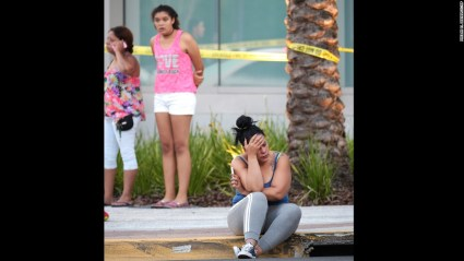 Friends and family members of victims of the Orlando massacre wait outside an Orlando Medical Center for word on their love ones. Photo: CNN