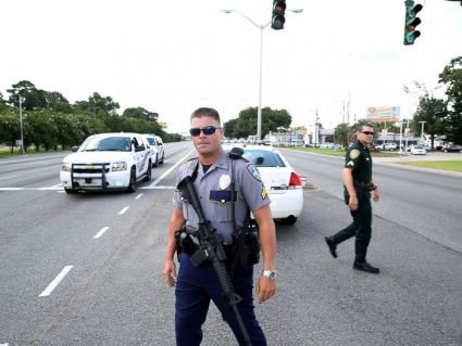 Baton Rouge, Louisiana police officers patrol the area of Baton Rouge shooting on Sunday, July 16, 2016. Photo Credit: Reuters/ Joe Penney