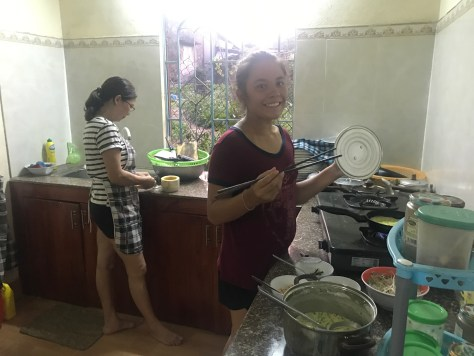 Kate helping our host cook dinner