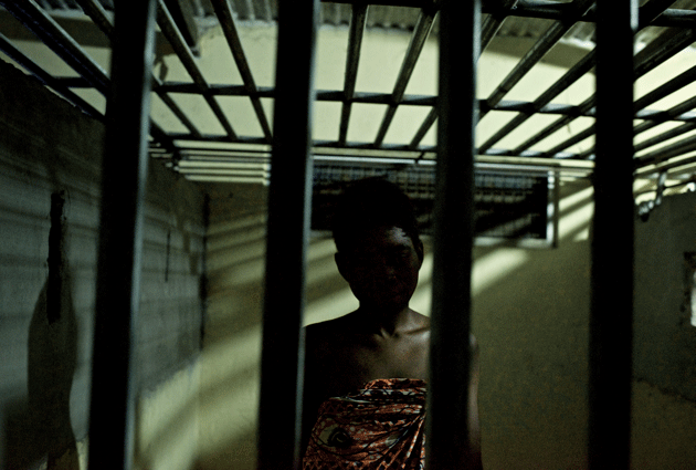 A patient in the restraint home at Edumfa, where those considered violent or at risk of running away are caged