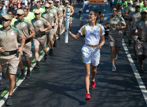 The Brazilian model and Victoria's Secret Angel Alessandra Ambrosio carries the Olympic torch through Rio.
