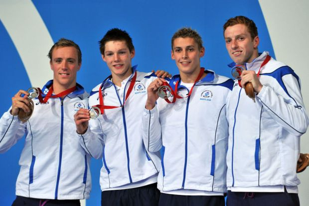 Day four: Silver medallists Daniel Wallace, Stephen Milne, Duncan Scott and Robbie Renwick pose during the Men's 4x200m Freestyle Relay medal ceremony.