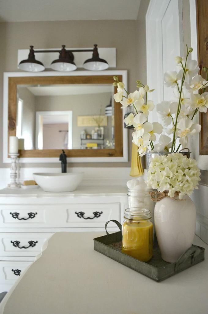 Farmhouse Bathroom Decor Ideas - Bright Farmhouse Bathroom with Wood and Flowers - harpmagazine.com