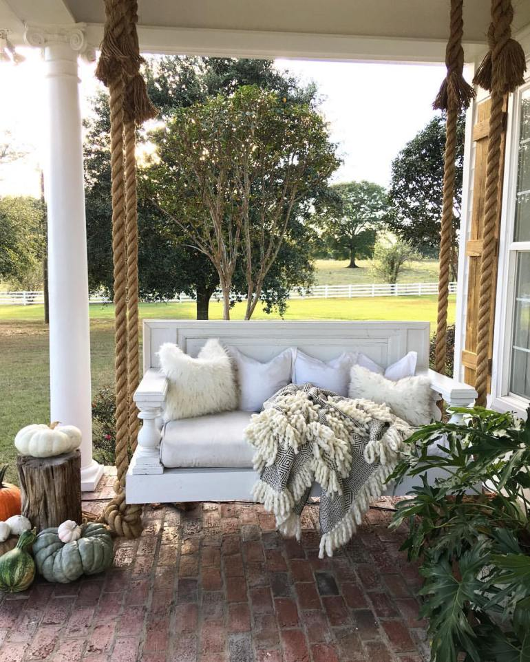 Farmhouse Porch Decorating Ideas - Hanging Manor Bed Porch Swing - Harpmagazine.com