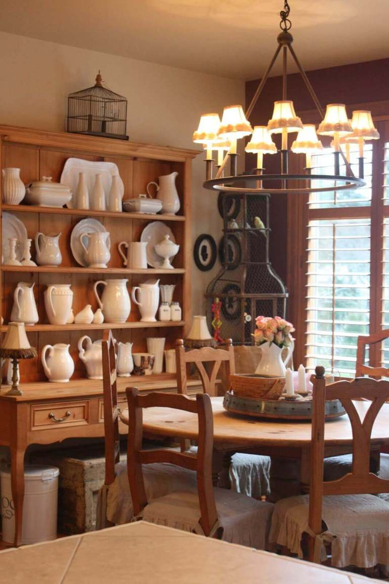 French Country Decor Ideas - Warm Wood Dining Room with Stoneware Display - Harpmagazine.com