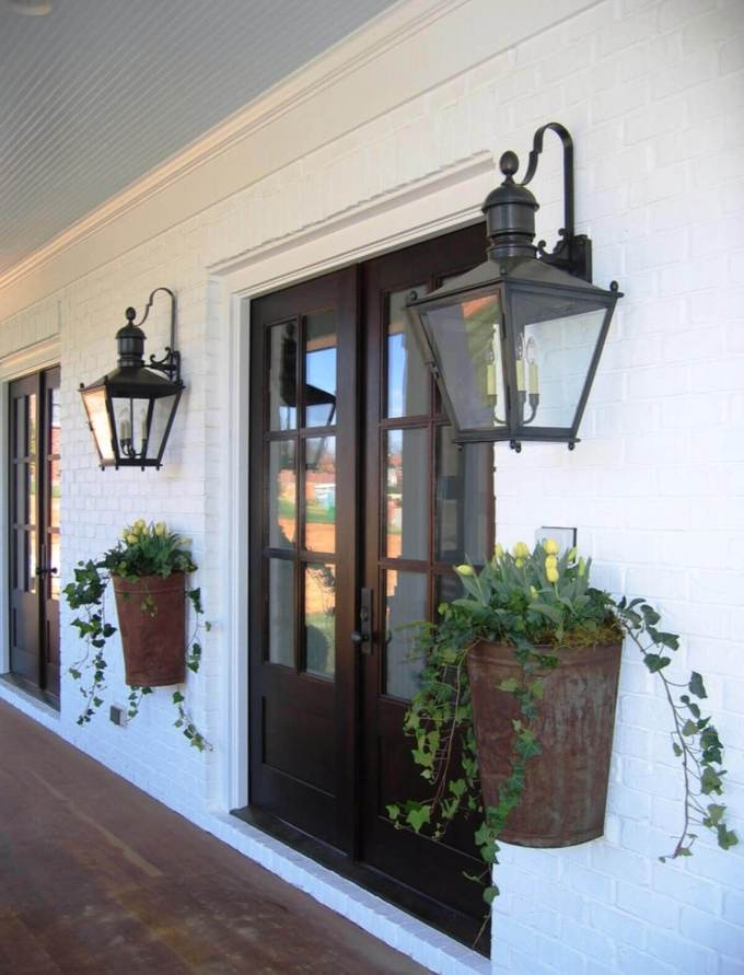 Farmhouse Porch Decorating Ideas - Old New Orleans Entryway Planters & Lanterns - Harpmagazine.com